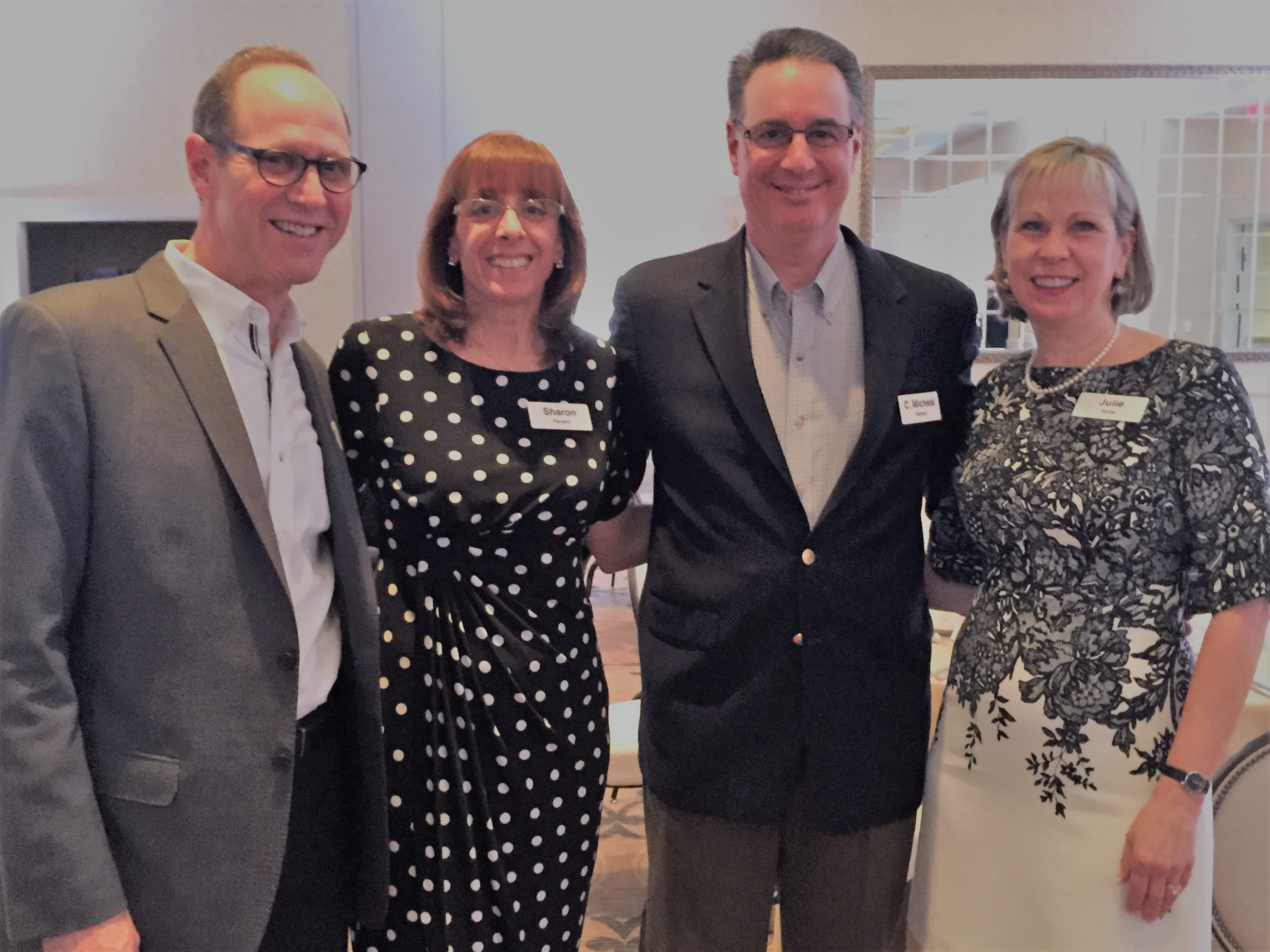 Sharon and C. Michael Ferraro (center) with Wiley senior leadership.